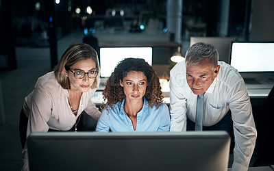 Buy stock photo High angle shot of three business colleagues businesswoman working late at the office