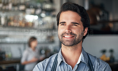 Buy stock photo Cropped shot of a handsome young man standing in his coffee shop