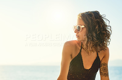 Buy stock photo Cropped shot of a beautiful young woman outside