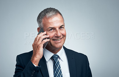 Buy stock photo Studio shot of a mature businessman on a call against a grey background