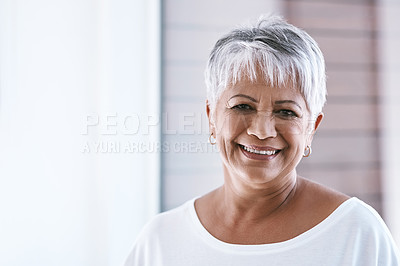 Buy stock photo Portrait of a cheerful mature woman with a bright smile looking at the camera