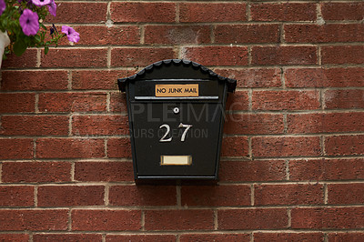 Buy stock photo Full length shot of a letter box on a wall
