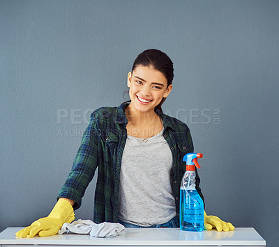 Buy stock photo Studio portrait of an attractive young woman doing some spring cleaning