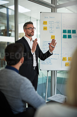 Buy stock photo Shot of businesspeople having a meeting in the office
