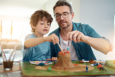 Buy stock photo Cropped shot of a handsome man helping his son build a volcano for school