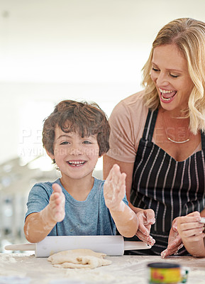 Buy stock photo Cropped shot of an attractive women baking with her son in the kitchen