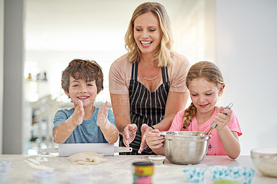 Buy stock photo Cropped shot of an attractive women baking with her two kids in the kitchen