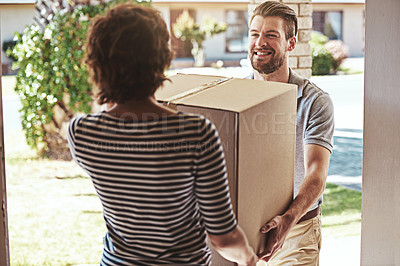 Buy stock photo Cropped shot of a handsome young male courier making deliveries