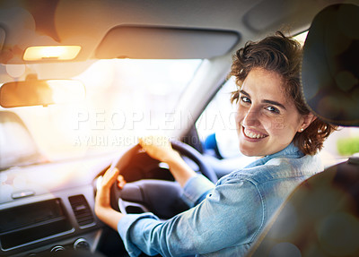Buy stock photo Portrait of a happy young woman driving a car