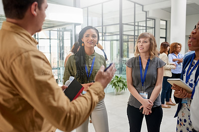 Buy stock photo Cropped shot of a group of businesspeople having a conversation in an office