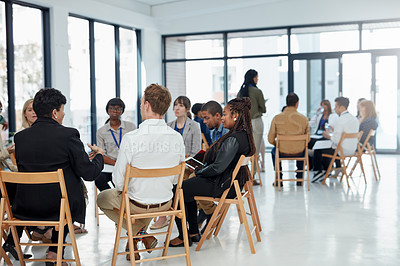 Buy stock photo Shot of a group of businesspeople sitting in the boardroom during a presentation