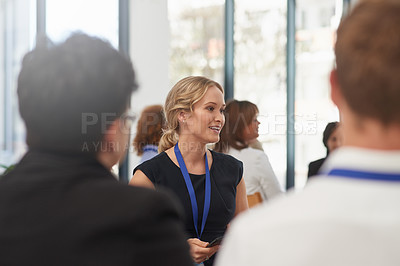 Buy stock photo Shot of a cheerful young businesswoman delivering a presentation to work colleagues inside a boardroom