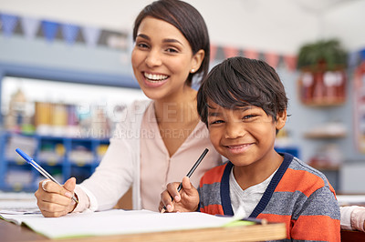 Buy stock photo Cropped shot of a teacher helping an elementary school child in class