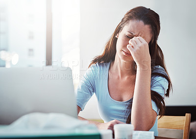 Buy stock photo Cropped shot of a young businesswoman trying to work while suffering with the flu