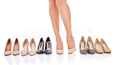 Buy stock photo Cropped shot of a woman standing between a selection of shoes