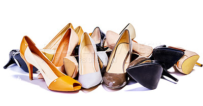 Buy stock photo Closeup shot of a selection of high heel shoes in a row isolated on white