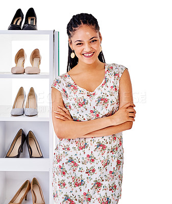 Buy stock photo Cropped shot of a woman standing next to a shelf packed with shoes