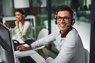Buy stock photo Portrait of young call centre agents working late in an office