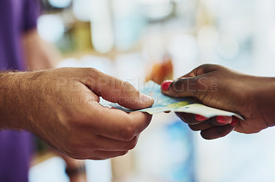 Buy stock photo Cropped shot of an unrecognizable customer making payment in a store