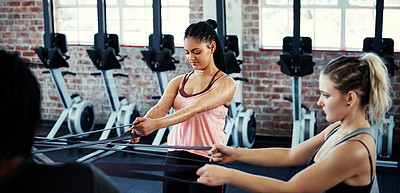 Buy stock photo Cropped shot of women working out with resistance bands