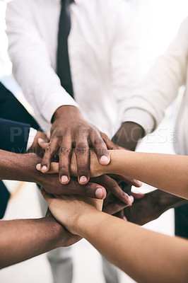 Buy stock photo Shot of a motivated group of unrecognizable businesspeople's hands forming a huddle