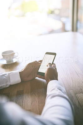 Buy stock photo Shot of a unrecognizable business person holding a cellphone and writing a message