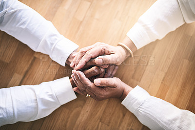 Buy stock photo Shot of two unrecognizable people holding hands in support for each other