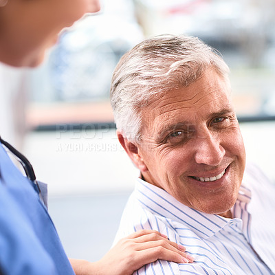 Buy stock photo Portait of a cheerful mature male patient's shoulder being held by a doctor inside of a clinic