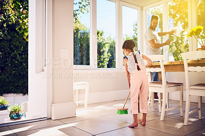 Buy stock photo Shot of a father and his little daughter doing chores together at home