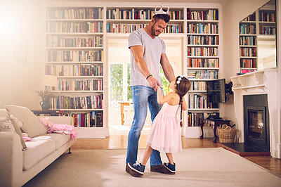 Buy stock photo Shot of a father bonding with his little daughter at home