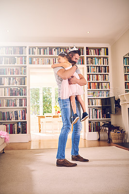 Buy stock photo Shot of a father hugging his little daughter at home