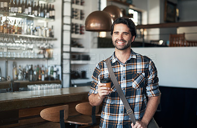 Buy stock photo Portrait of a cheerful young man standing with a coffee in his hand inside of a restaurant