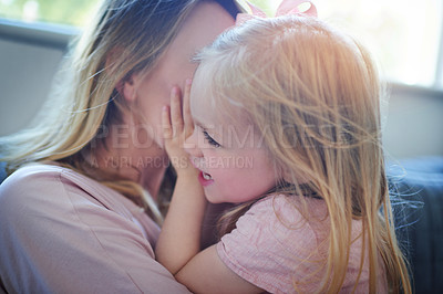 Buy stock photo Shot of an adorable little girl bonding with her mother at home