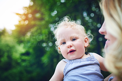 Buy stock photo Shot of an adorable baby girl bonding with her mother during a day outdoors