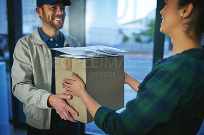Buy stock photo Shot of a delivery man making a delivery to a customer at her home