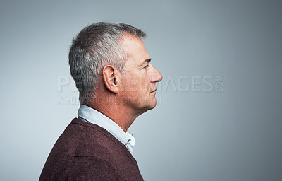 Buy stock photo Studio profile of a mature man against a gray background