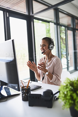 Buy stock photo Shot of a cheerful businesswoman talking to a customer using a headset while clapping her hands