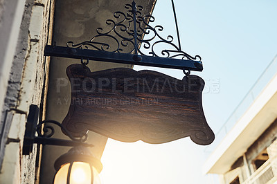 Buy stock photo Shot of a blank sign Cropped shot of a blank sign hanging outside