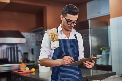 Buy stock photo Shot of a man working at a restaurant