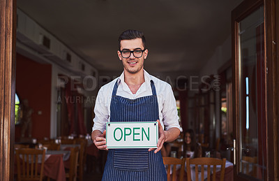 Buy stock photo Shot of a man putting the open sign up at a restaurant
