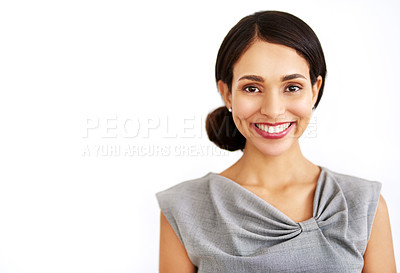 Buy stock photo Studio portrait of an attractive young businesswoman posing against a white background