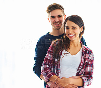 Buy stock photo Cropped portrait of a handsome young man embracing his girlfriend in their home