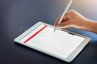 Buy stock photo Closeup shot of an unrecognizable businesswoman using a stylus on a digital tablet