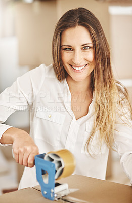 Buy stock photo Cropped portrait of an attractive young woman sealing a box on moving day