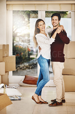 Buy stock photo Full length portrait of an affectionate young couple dancing while moving into a new home