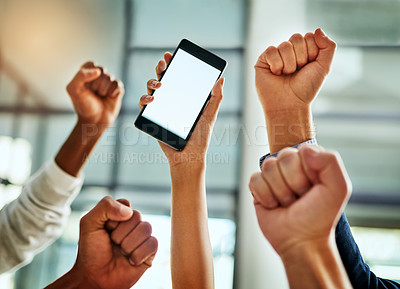 Buy stock photo Cropped shot of a group of businesspeople cheering and holding a mobile phone in a modern office
