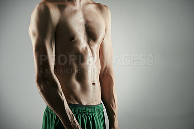 Buy stock photo Studio shot of an unrecognizable young sportsman posing shirtless against a grey background
