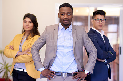 Buy stock photo Portrait of a group of confident young businesspeople standing together in an office