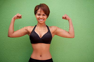 Buy stock photo Cropped shot of a beautiful young woman in shape posing against a green background