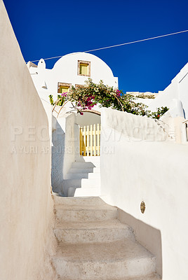 Buy stock photo Shot of a beautiful constructed white building with steps running down the side outside during the day
